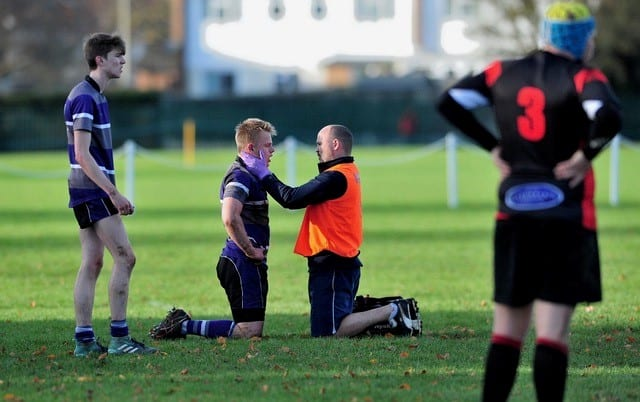 Wycliffe Student Physio Holding Head
